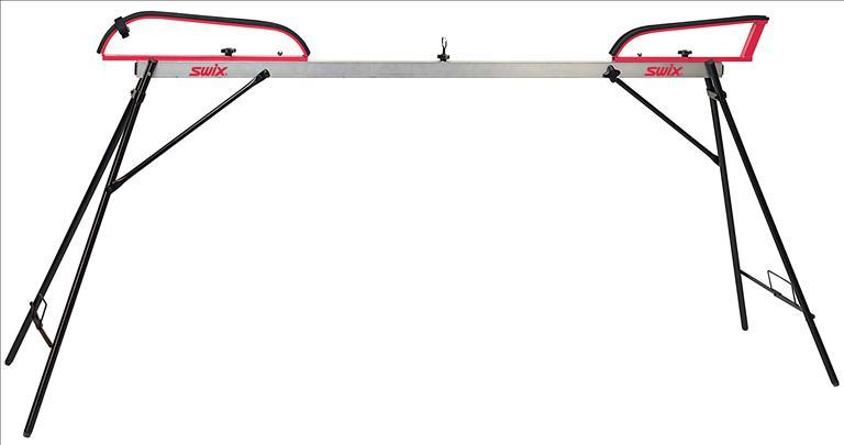 Такой станок-профиль на раскладных ножках очень удобен при подготовке лыж. Огромным достоинством такой конструкции является то, что ей не нужны никакие столы – этот станок можно установить абсолютно в любом месте.